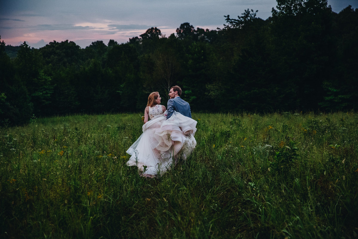 A bride and groom in a wildflower field