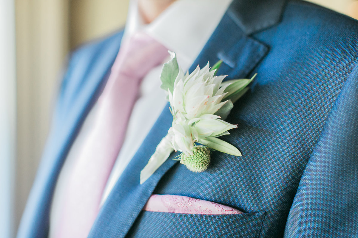 White Boutonniere Blue Suit