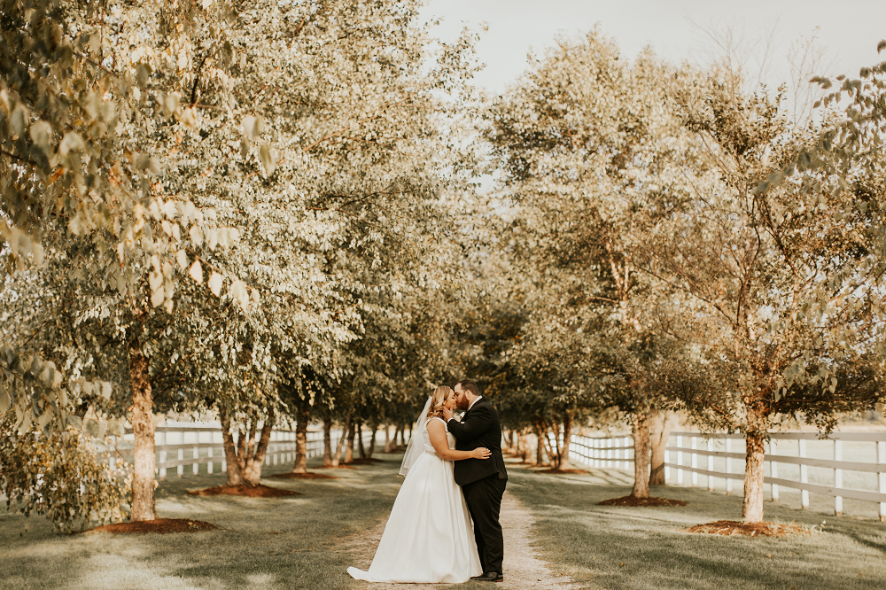 Rustic Farm Wedding Bride and Groom in Orchard