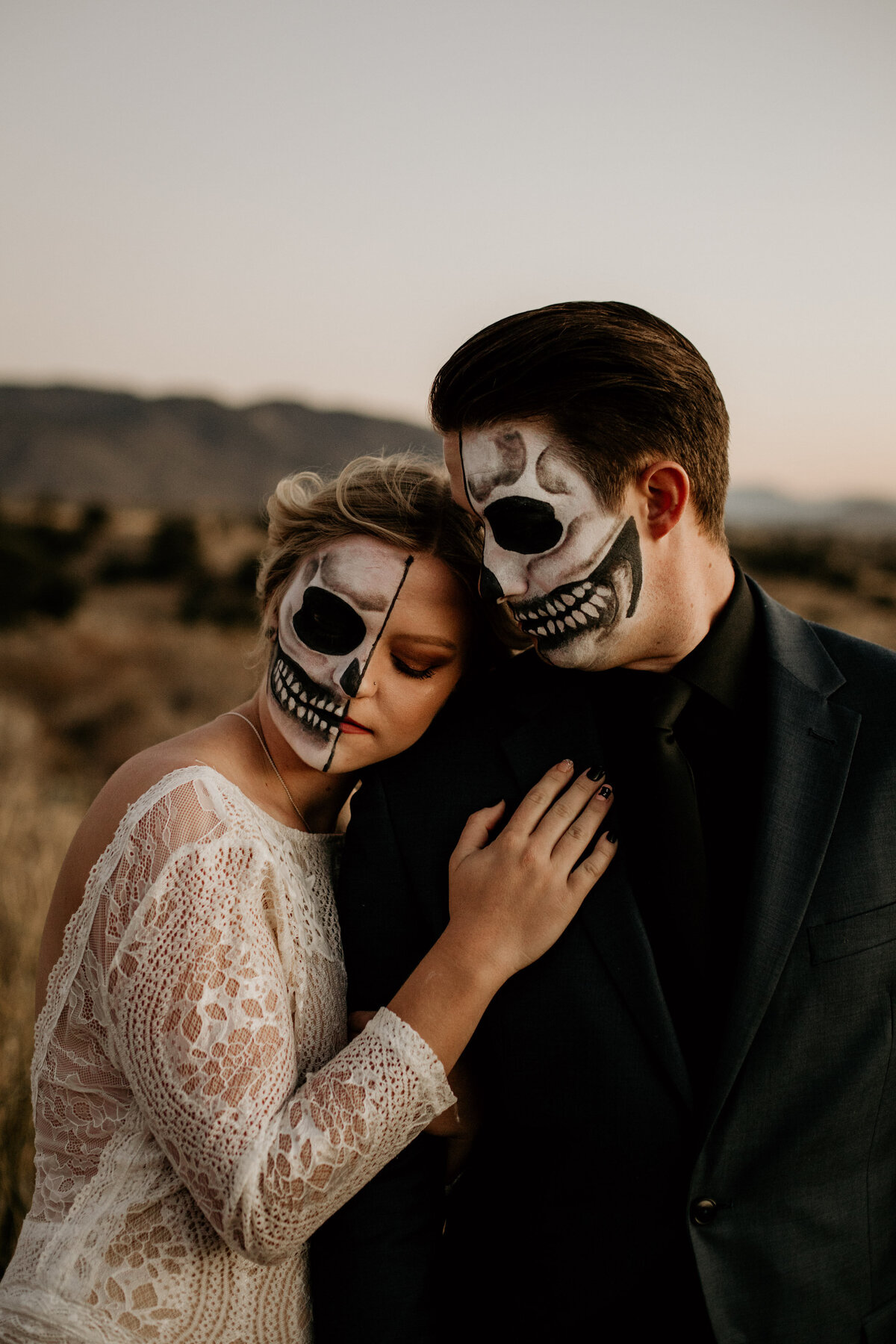 skeleton bride leaning on skeleton groom