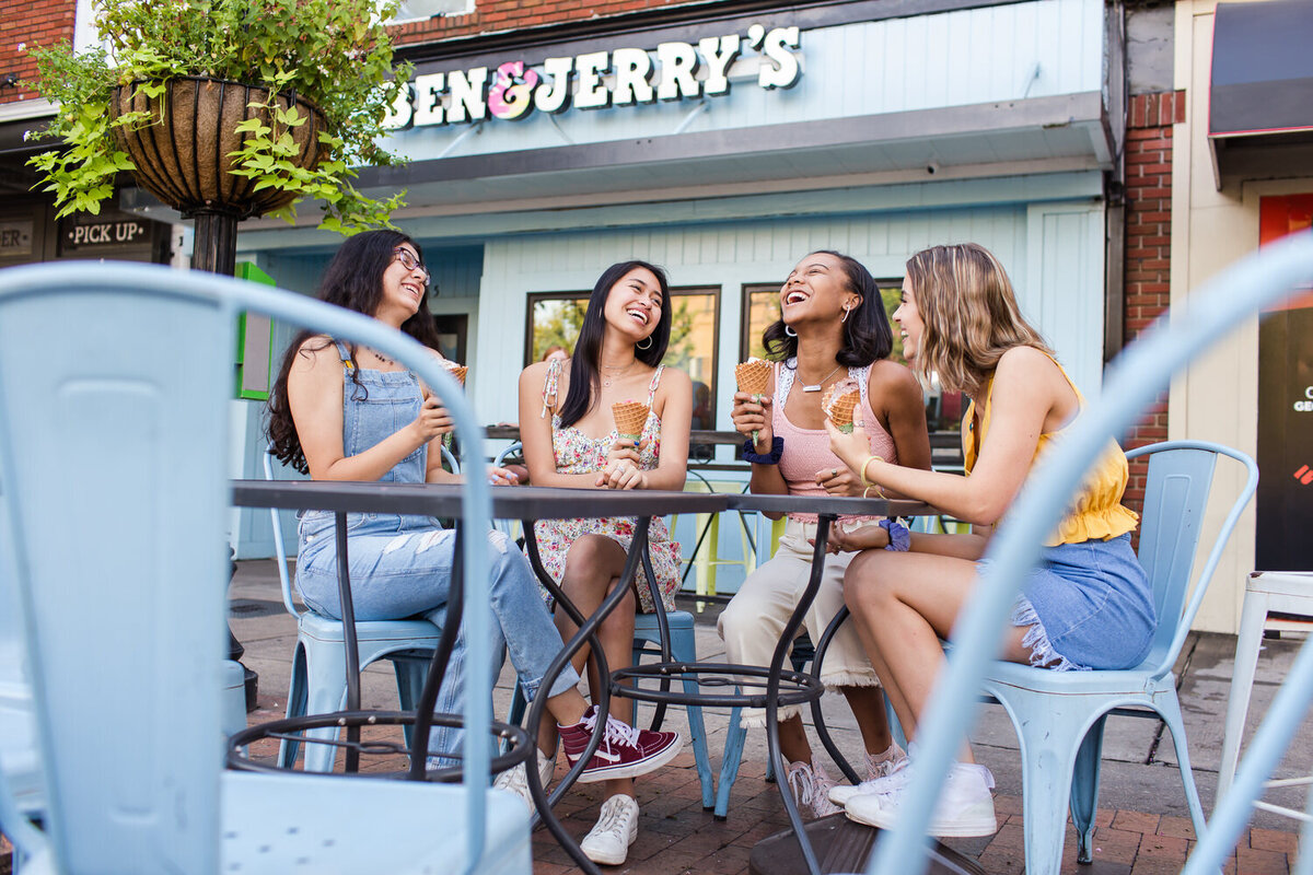 four high school seniors eating ice cream at ben and jerrys