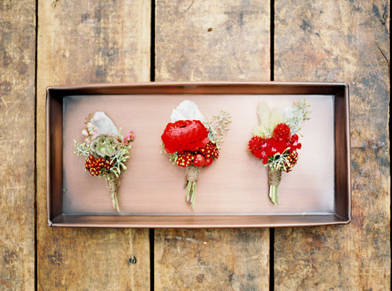 red boutonnieres rustic