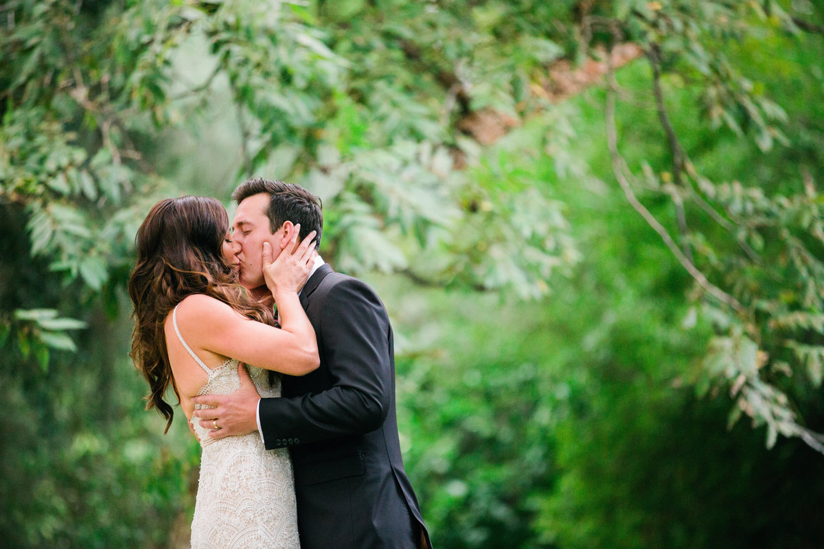 Couple embraces for their first kiss as husband and wife