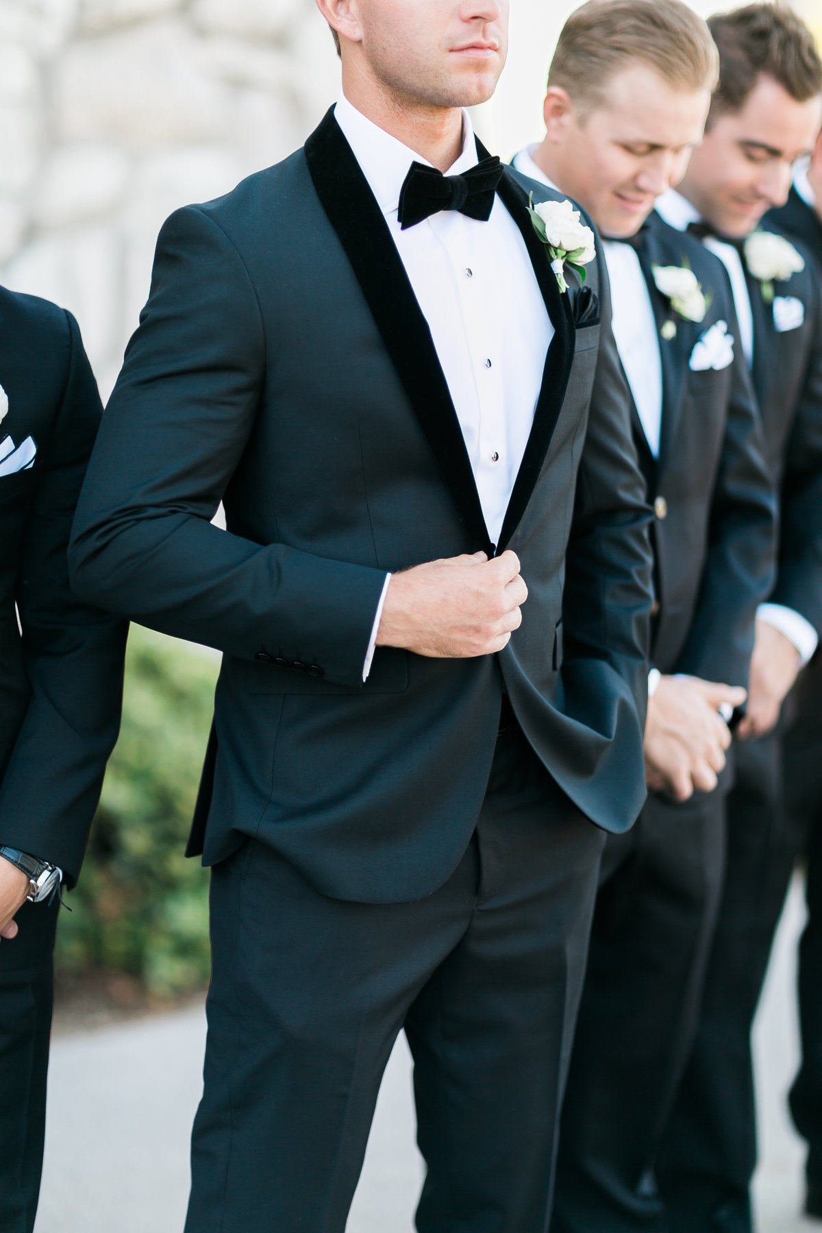 groom and groomsmen black tux with bowtie