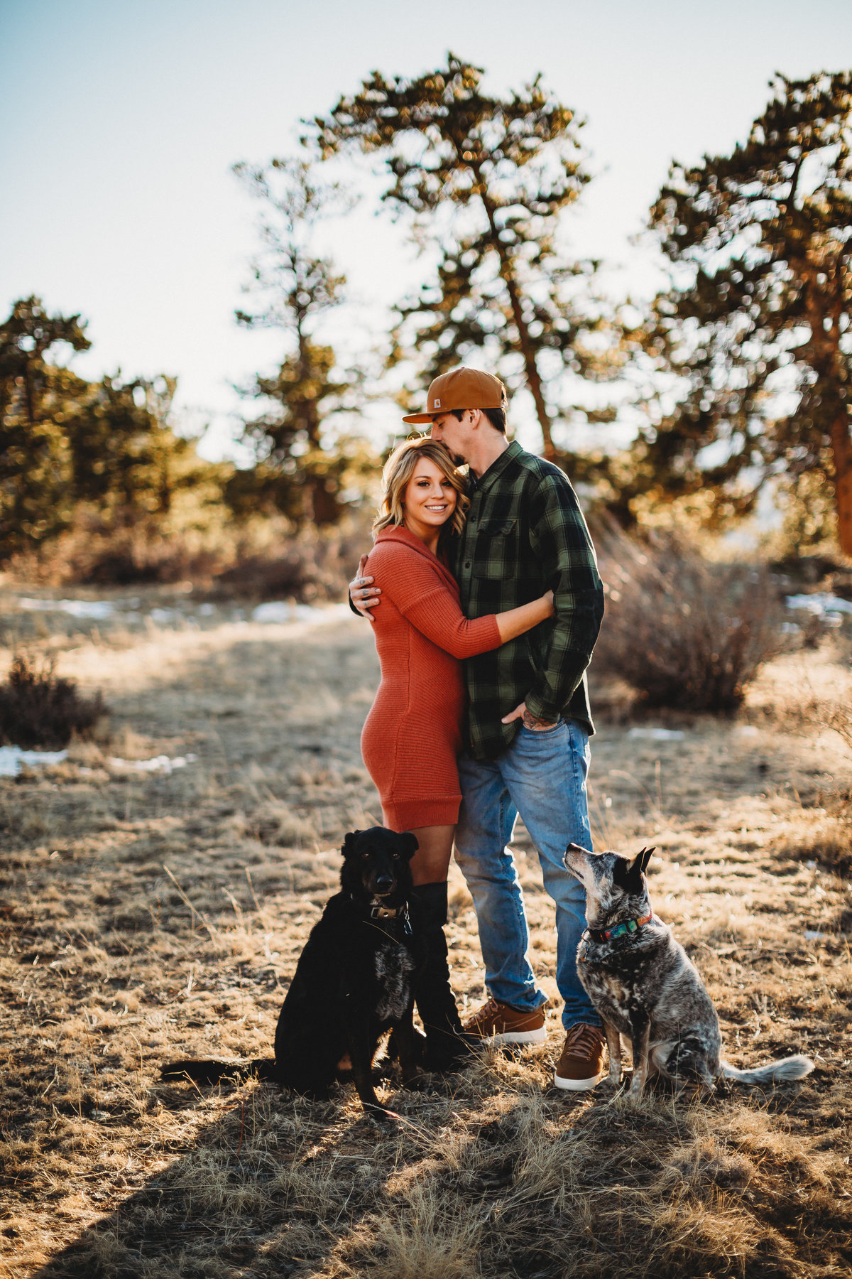 Engagement photo with dogs in Estes Park, Colorado