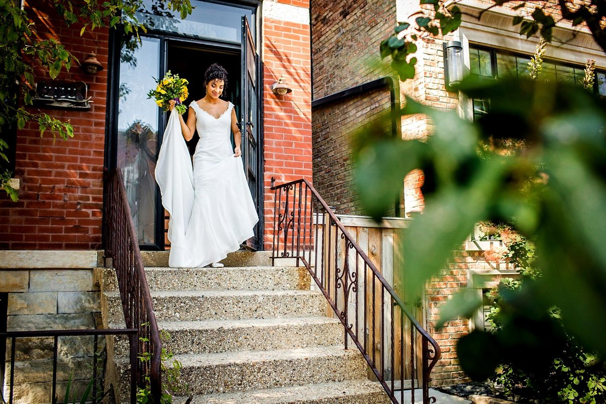 A bride walks down the stairs on the way to her Garfield Park Conservatory wedding.
