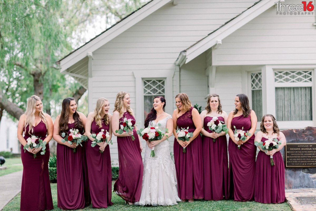 Bride and Bridesmaids share a laugh together during the photo session