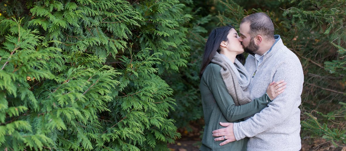 Husband and Wife kissing in a winter family session in White Plains, NY Photo