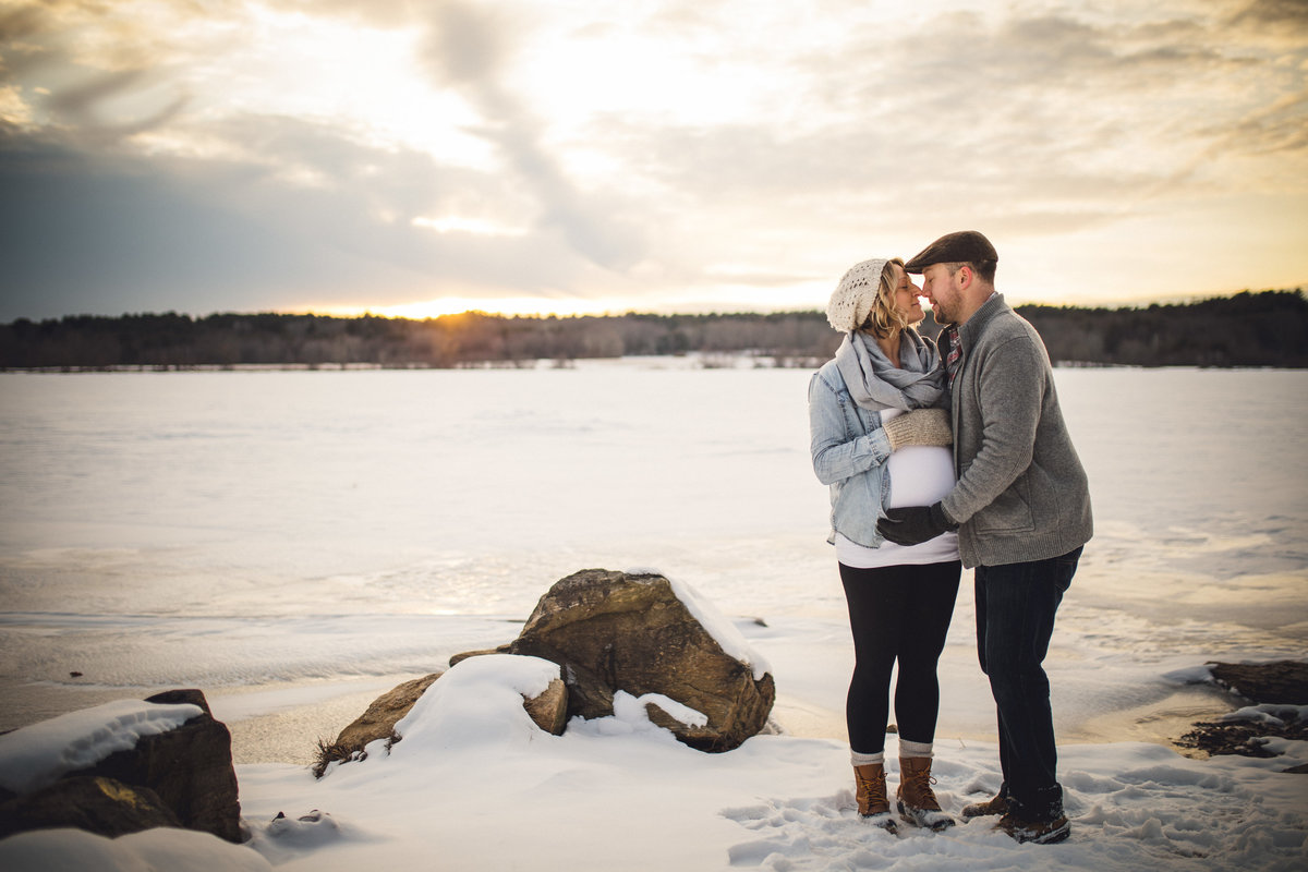 03 maternity photo on beach at sunset in wintertime ct