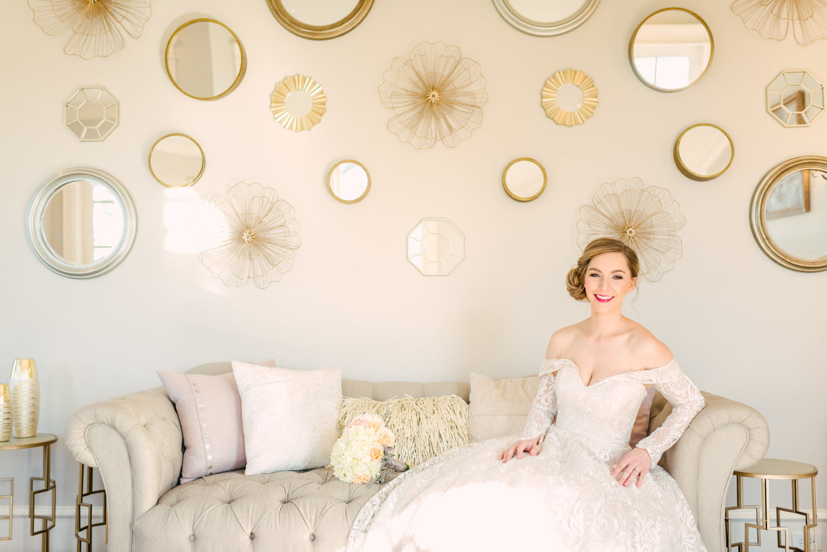 bride poses in bridal suite