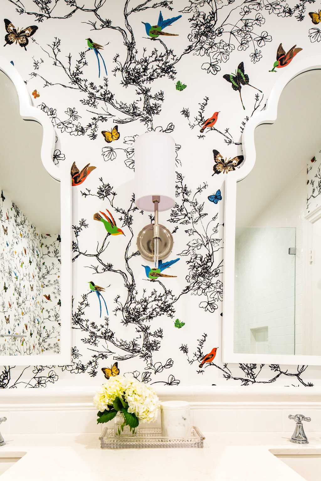 Bathroom with Schumacher Birds wallpaper and hexagon tile