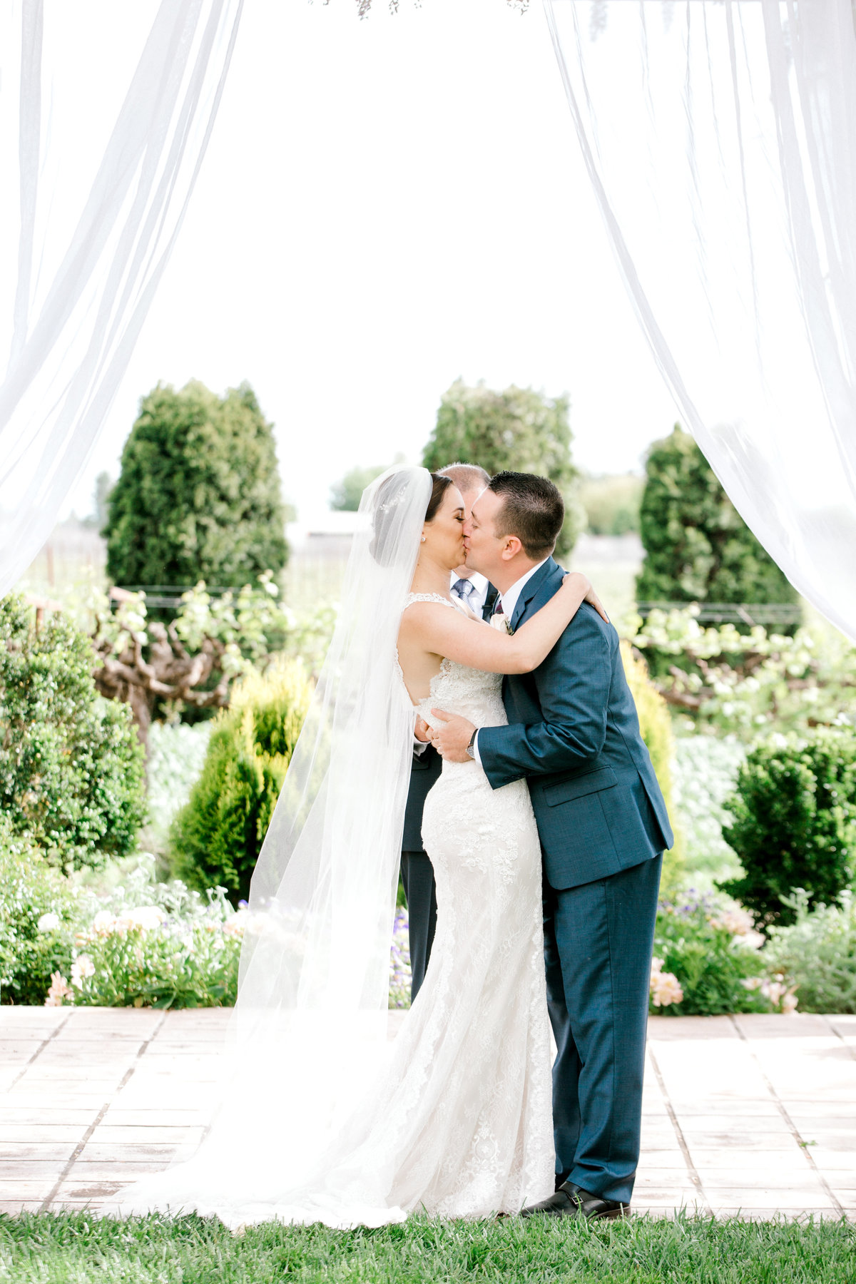 Bride and groom share first kiss as husband and wife at Vintners Inn in Santa Rosa California