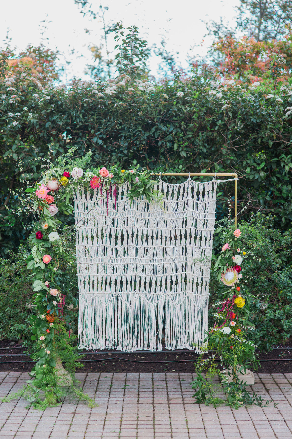 Closeup of boho floral macrame wall for wedding ceremony at Madrona Manor in Healdsburg California