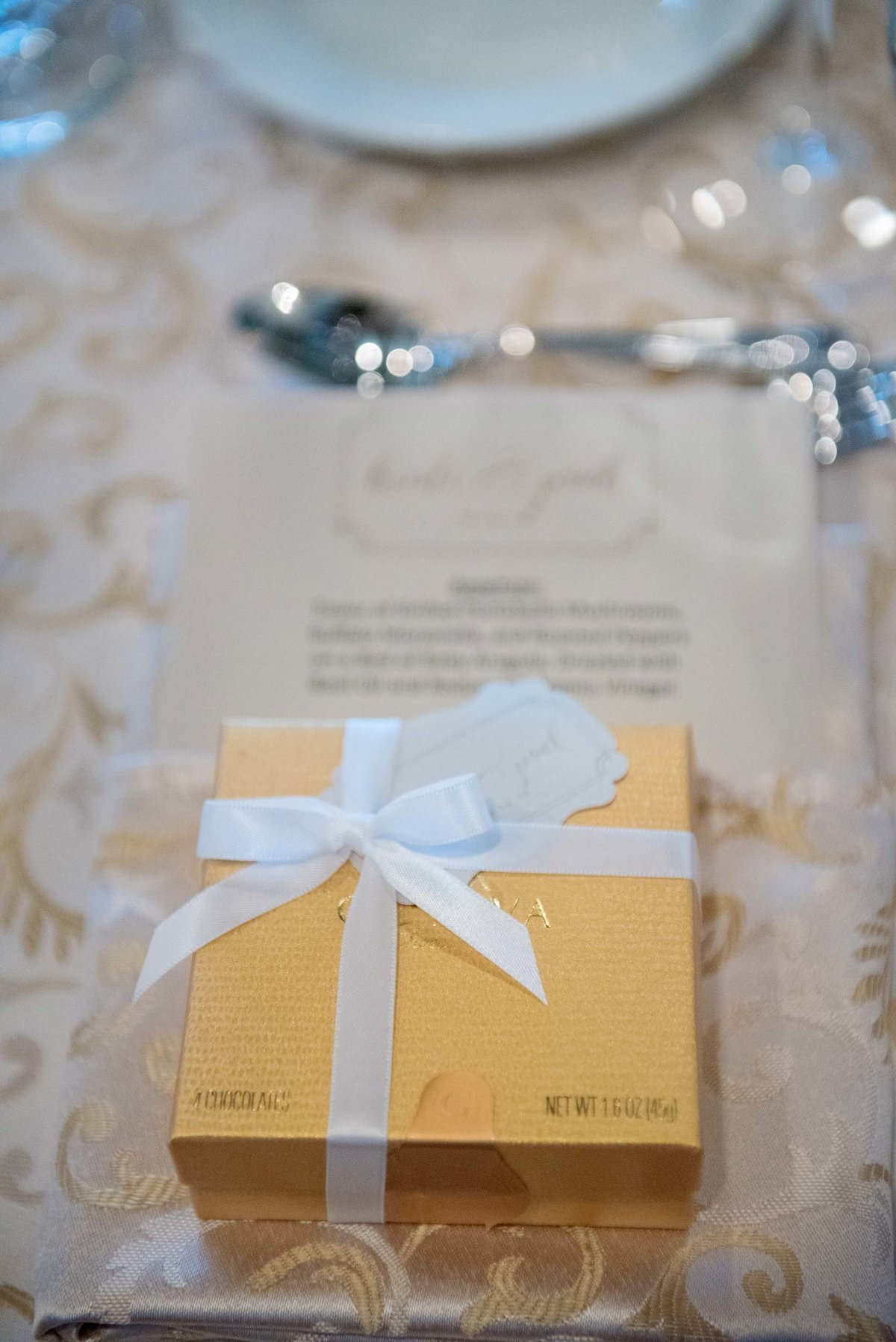 Table setting and gift box at Huntington Crescent Club