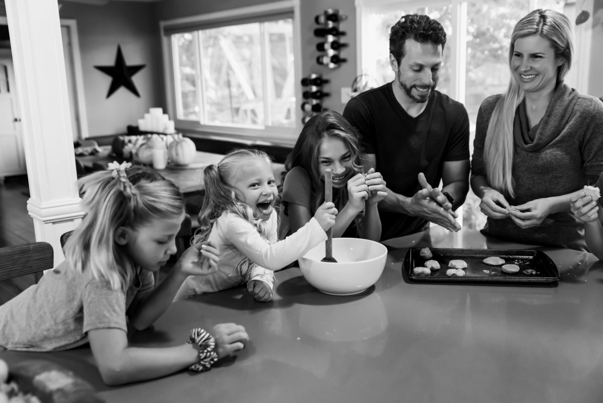 family baking cookies in their kitchen during lifestyle family photography session