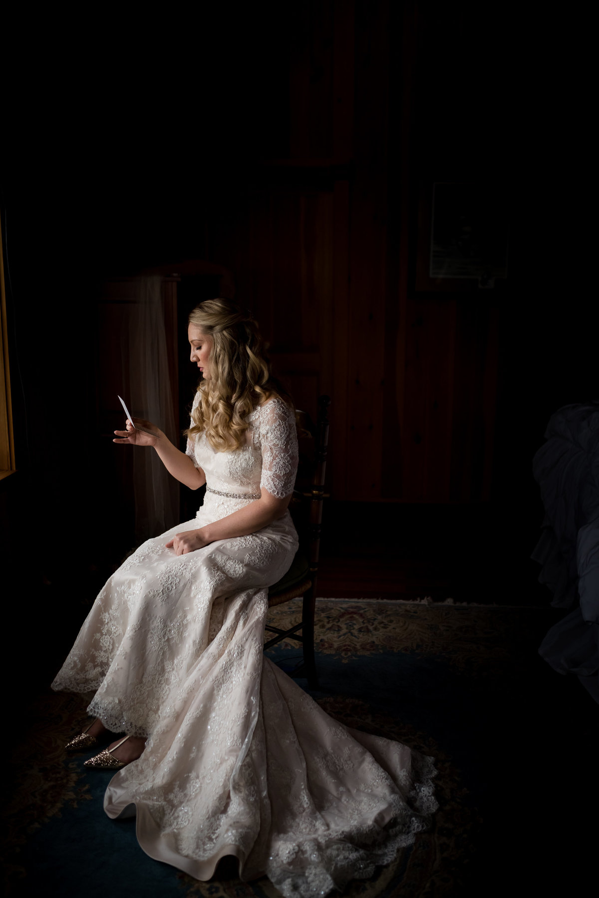 bride reading a letter from her groom
