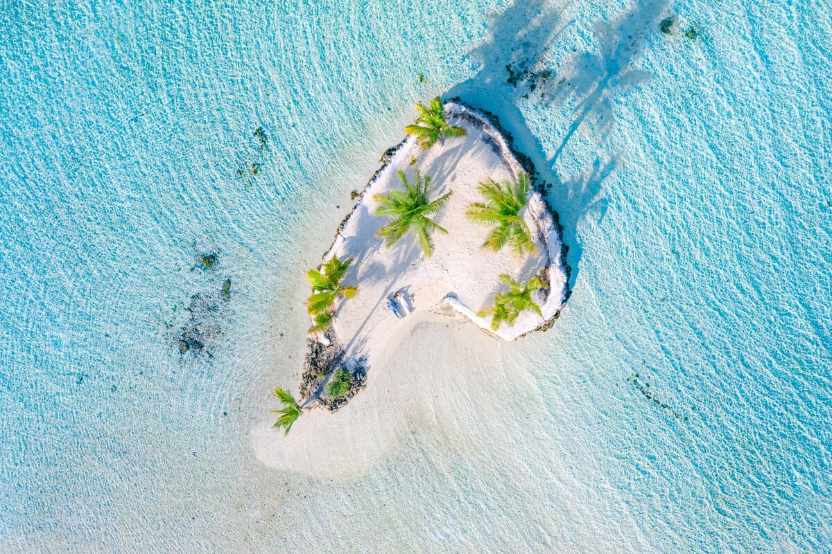 Aerial Drone View with the bride and groom in the heart at Le tahaa island resort