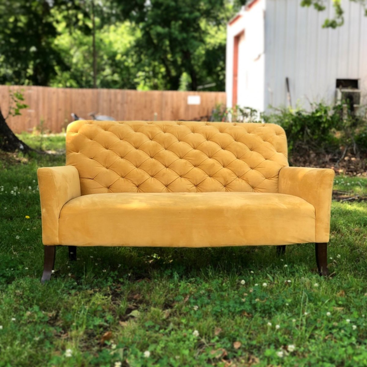golden tufted loveseat