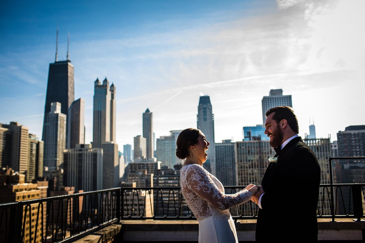 A couple shares a moment together on the rooftop of the Ambassador Hotel.