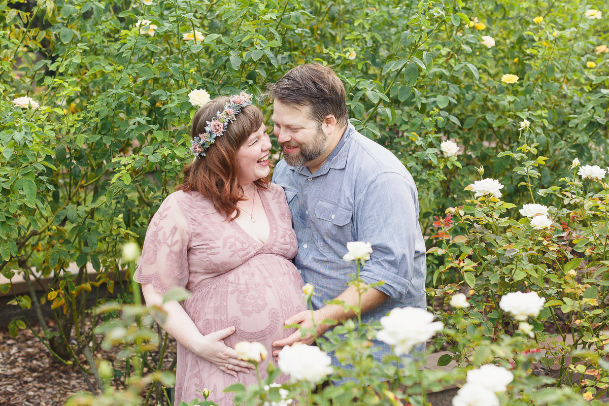 Washington Oaks Maternity Photo Session with Mother and Father in a Garden with White Roses