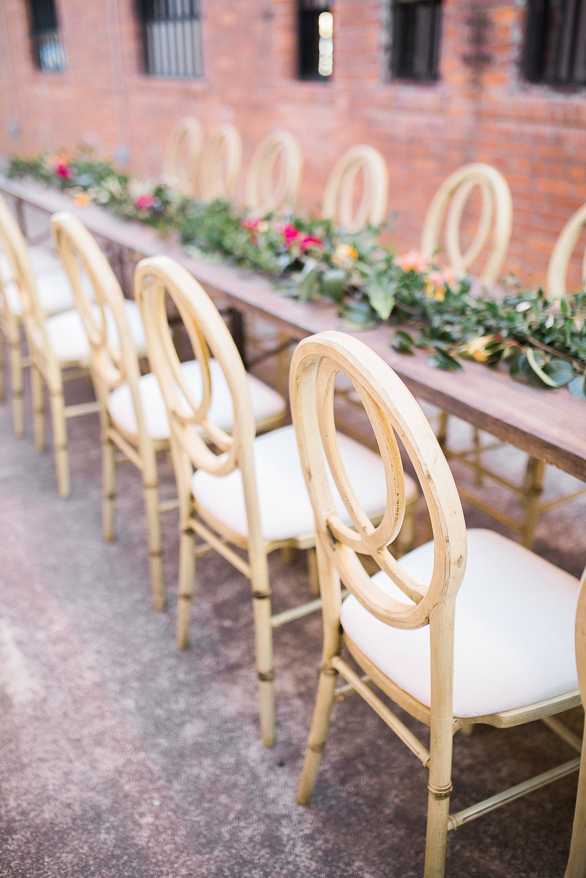 Wedding Photographer, detail shot of chairs at the reception