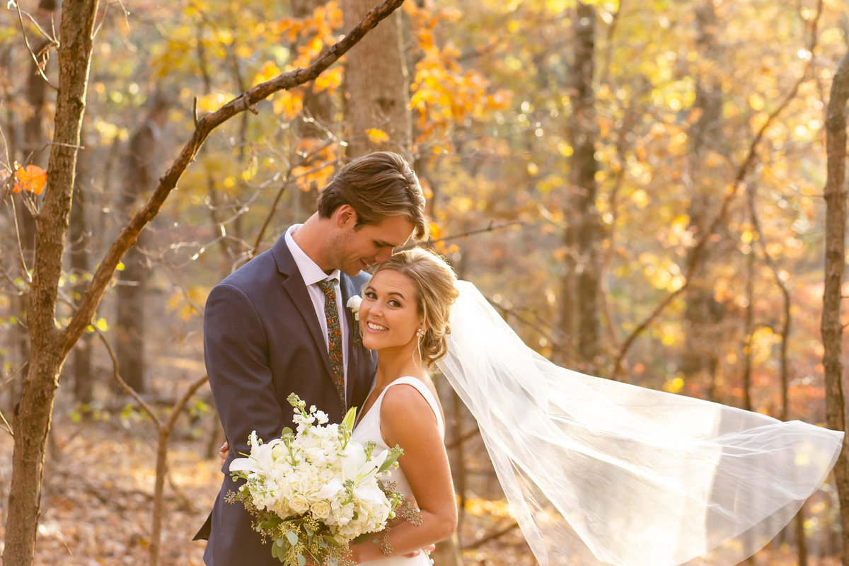 Romantic Fall Elopement  bride and groom in Fall leaves  at Greensfelder County Park in St. Louis  by Amy Britton Photography Photographer in St. Louis