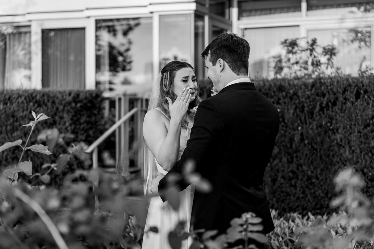 emotional first look between bride and groom at Olympic Village wedding