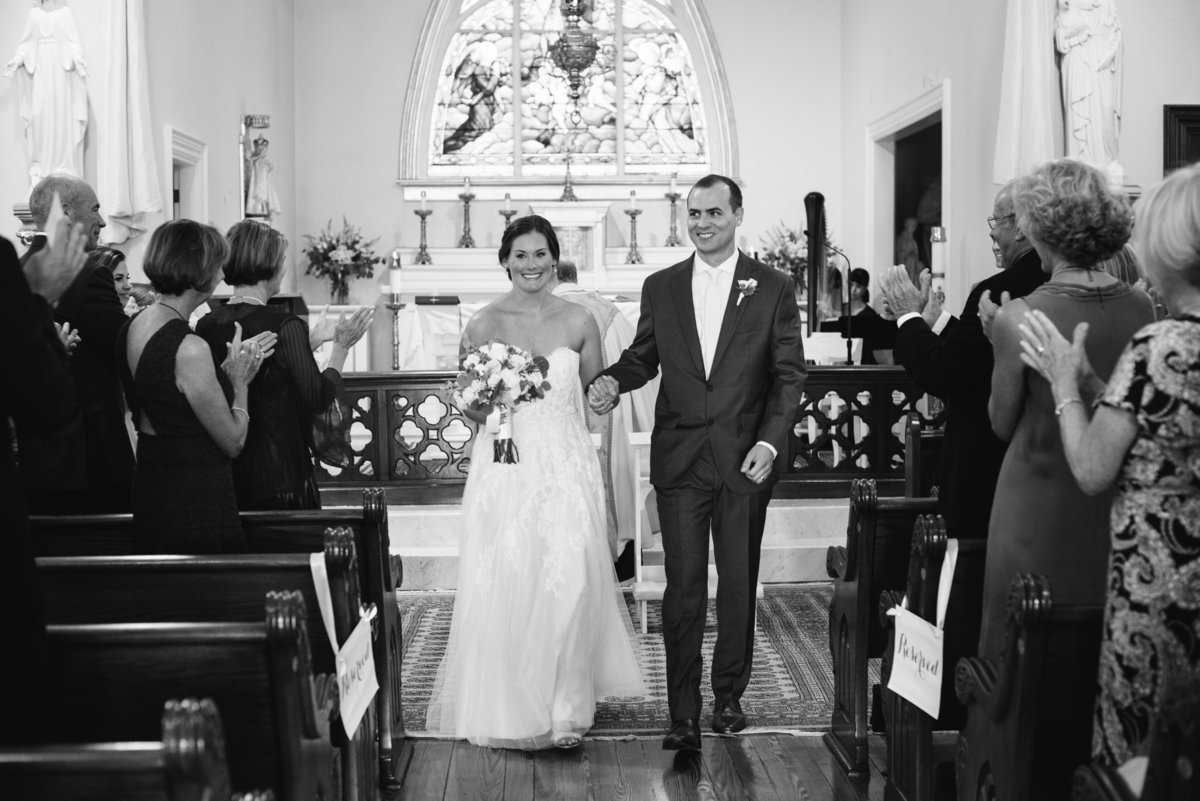 Bride and groom recessional in church