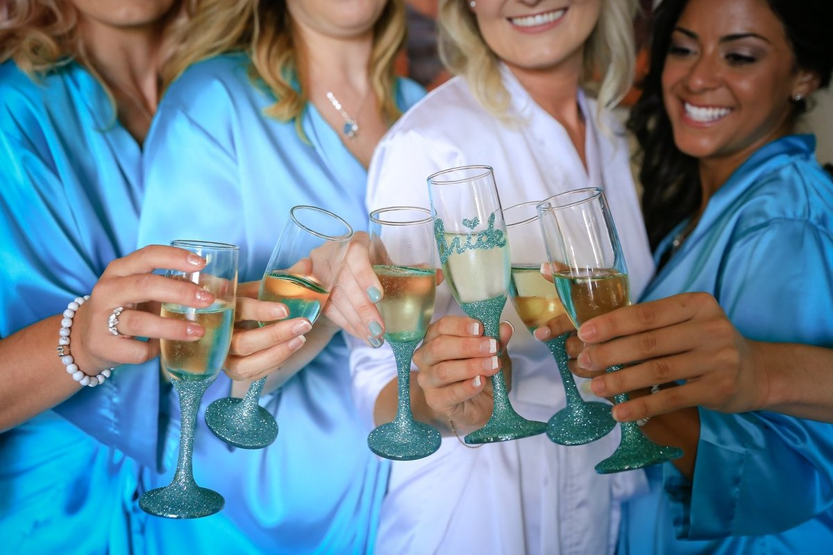 Maui Wedding Photography at The Westin Maui Resort and Spa of the  bride and bridesmaids toasting