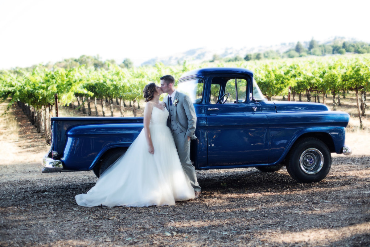 bride and groom romantics, bride and groom with blue truck, bride and groom wine country