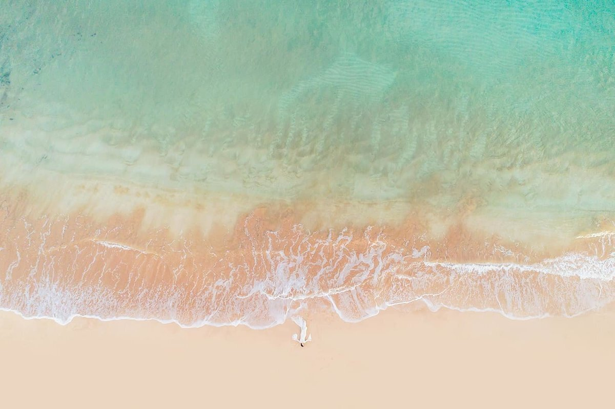 Drone portrait on Maui of woman laying in the sand