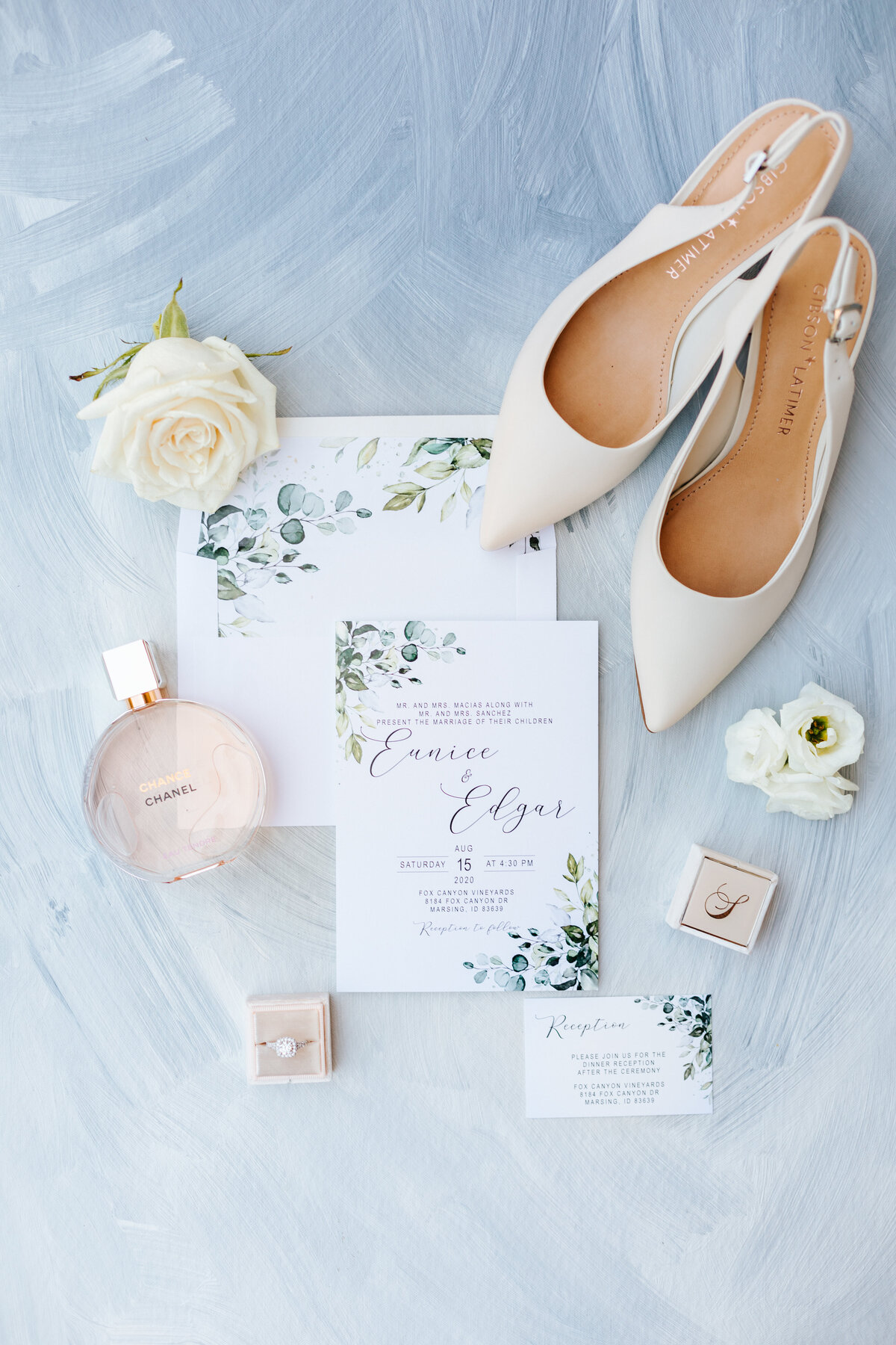 Wedding Details Flatlay against Dusty Blue Background with Chanel Perfume, Mrs. Box