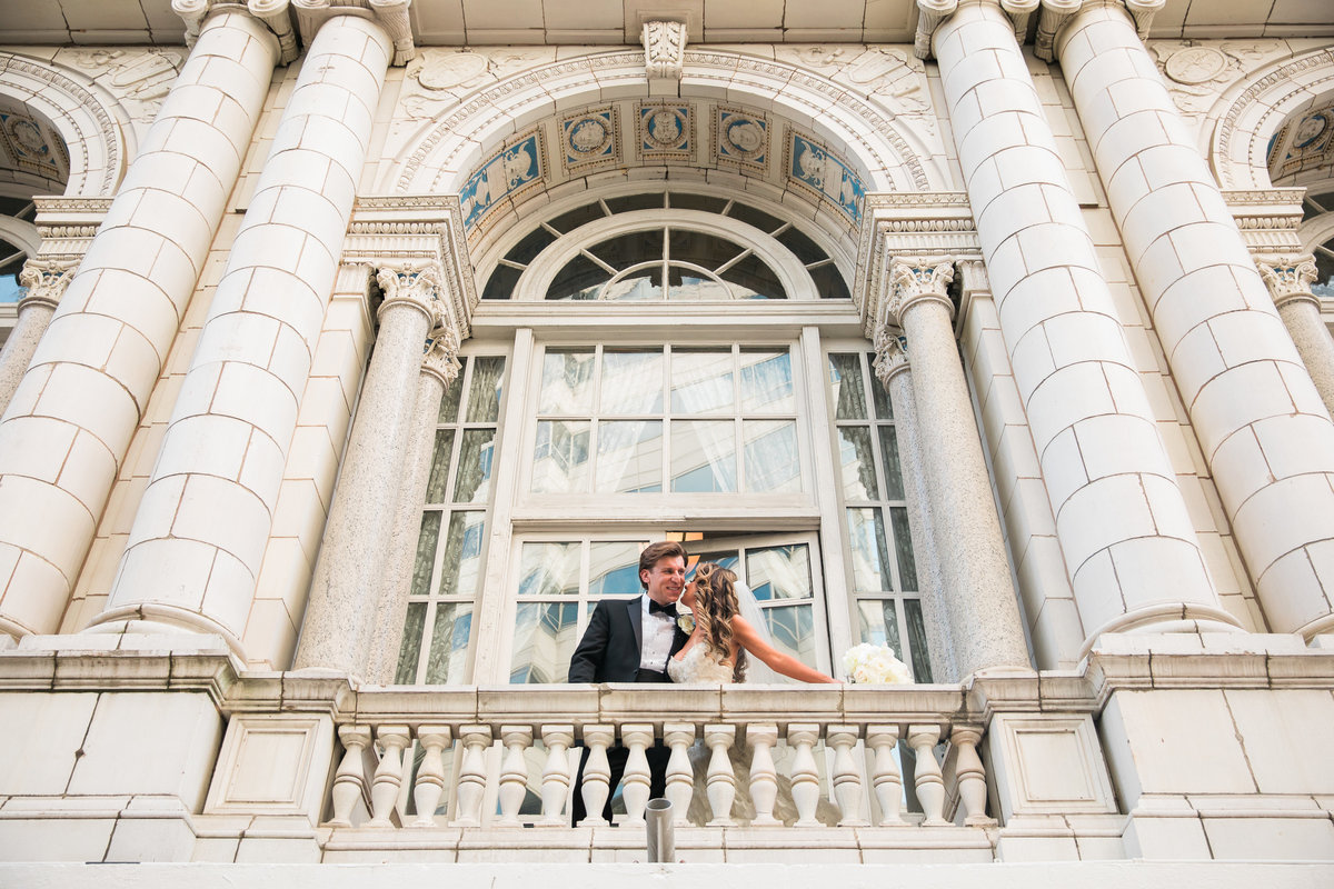 Bride and  Groom on the balcony at the Hermitage Hotel.