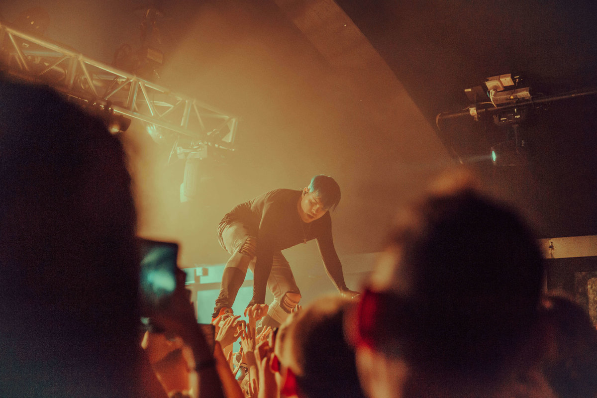 Cody Carson of Set It Off, performing at The Garage in London, stood on top of the crowd