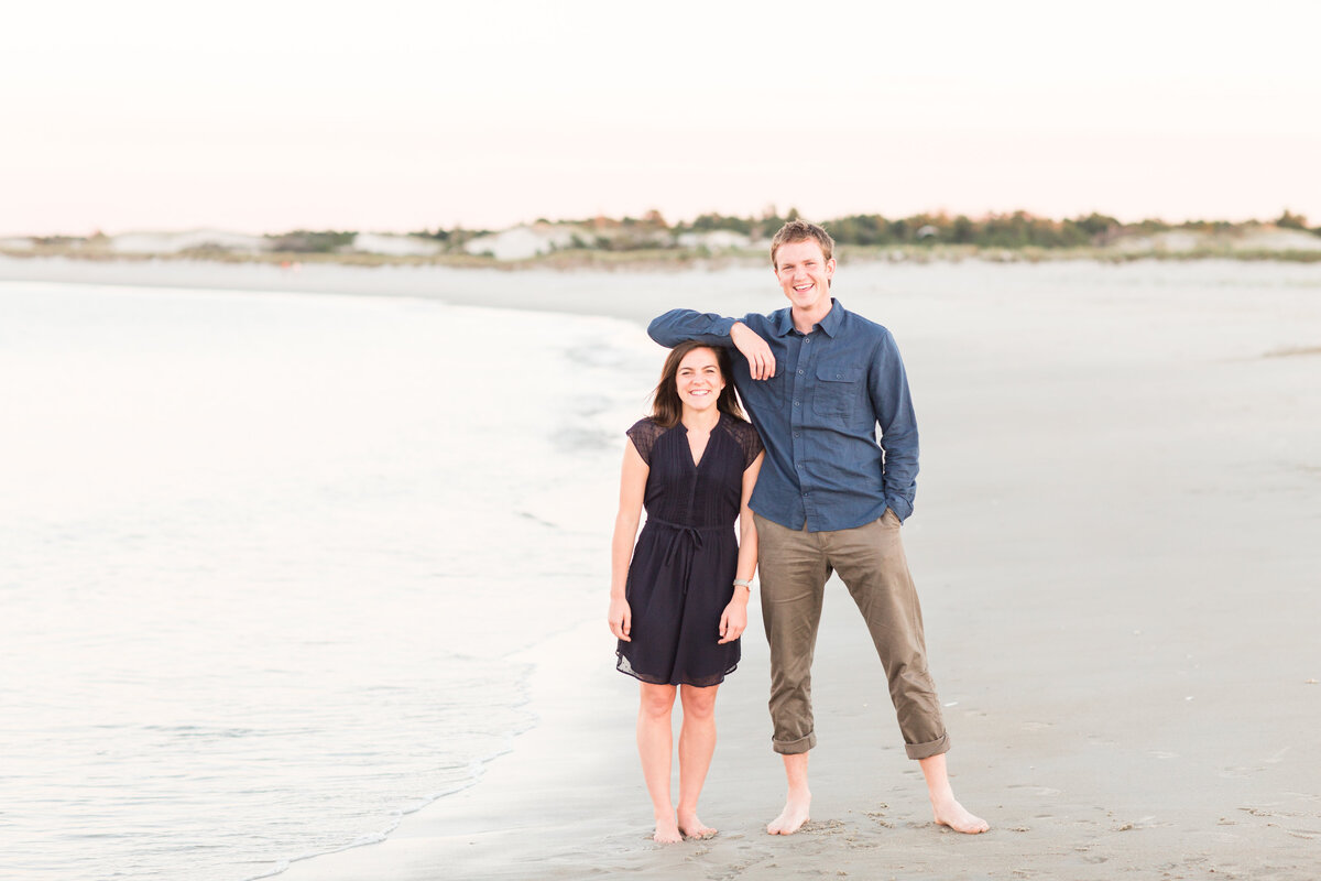 couple standing on beach in New England