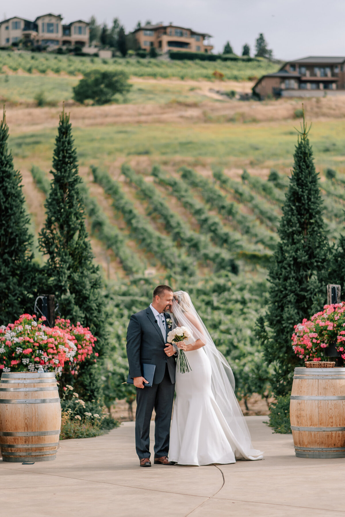Father walking bride down the aisle during wedding ceremony at Karma Vineyards in Chelan, WA