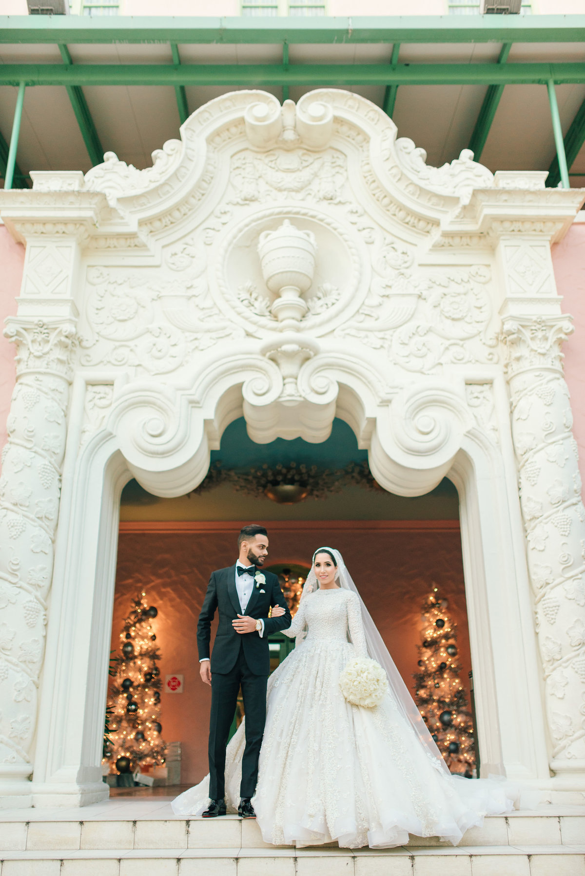 Bride and groom in front of Vinoy Renaissance entrance