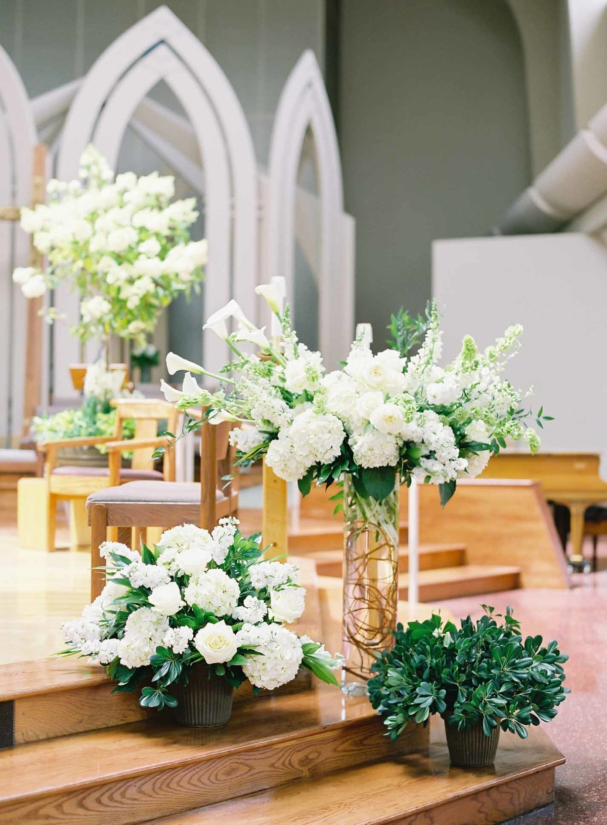 Beautiful white floral display for a wedding ceremony at Sacred Heart Church.
