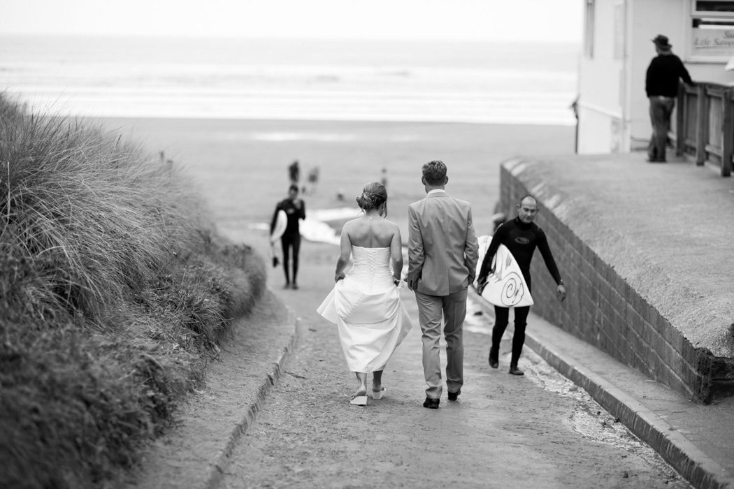 Bride and Groom with surfers at Woolacombe Bay Hotel Wedding
