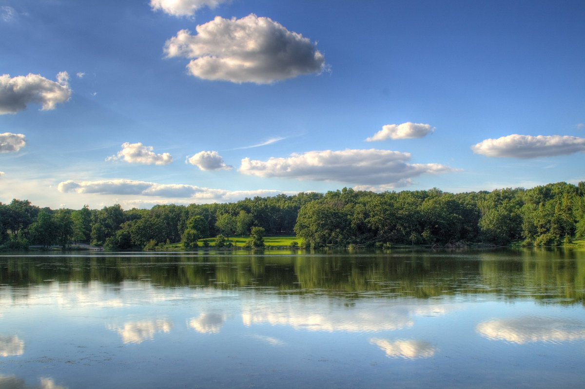 clouds in reflection at rock state park in illinois
