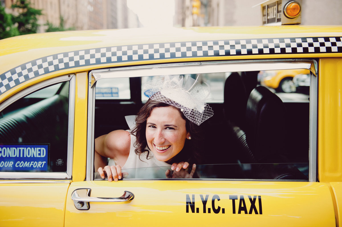 fun nyc elopement taxi cab nyc new york city central park happy love candid photography
