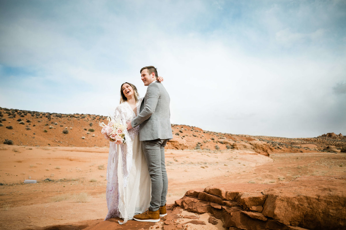 laughing couple during their page arizona elopement aimee flynn photo
