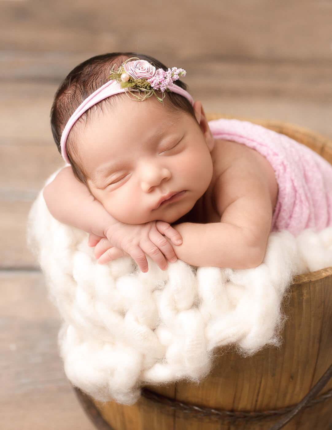 Posed newborn girl at our in-home Rochester, Ny studio.