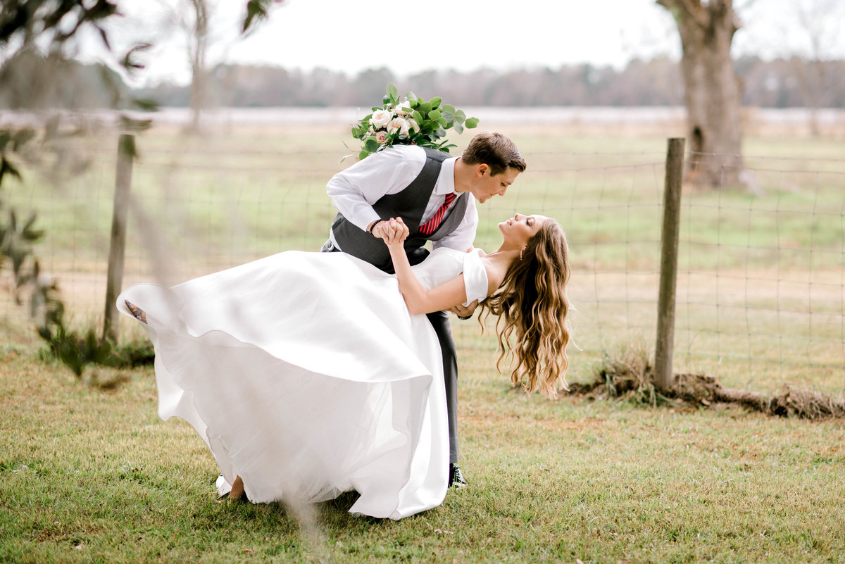 Groom dips bride during first look at Woodlawn Plantation