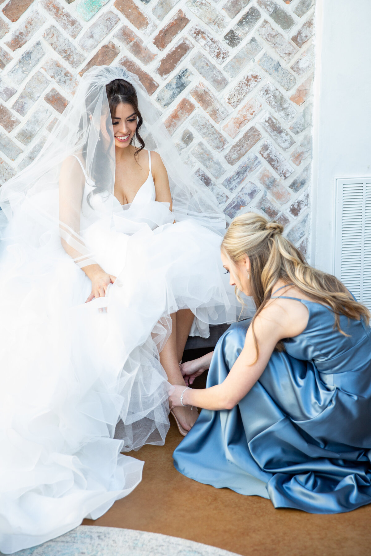 Maid of Honor Putting on Bride's Shoes