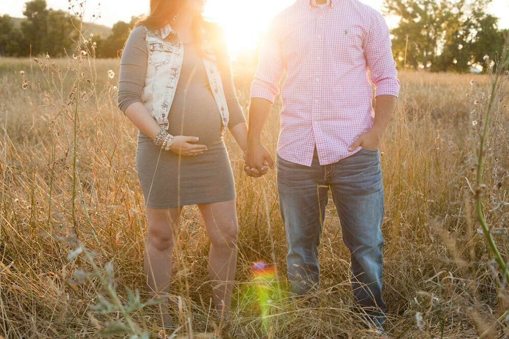 outdoor filed maternity couple jeans and  grey dress