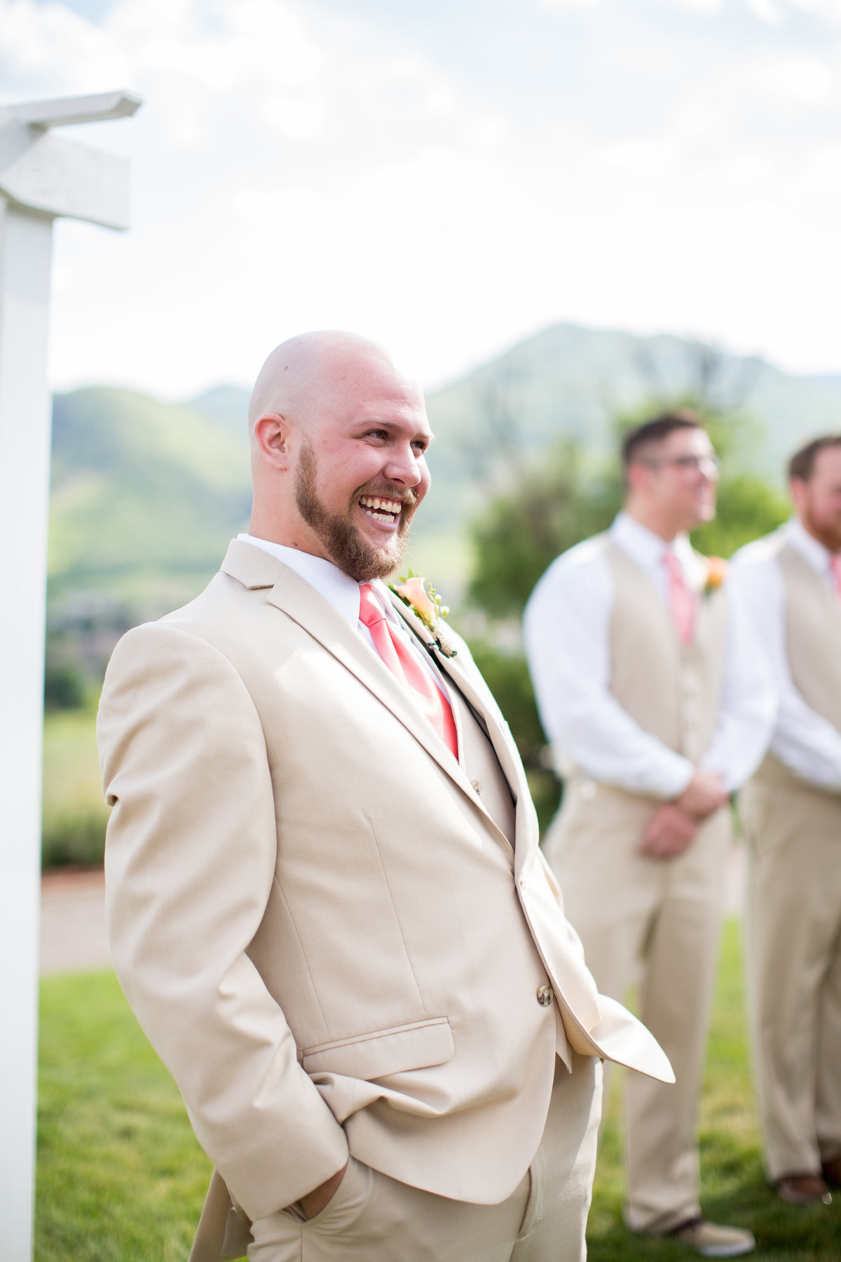 Groom's reaction to his bride walking down the aisle captured by Melissa Sue Photography