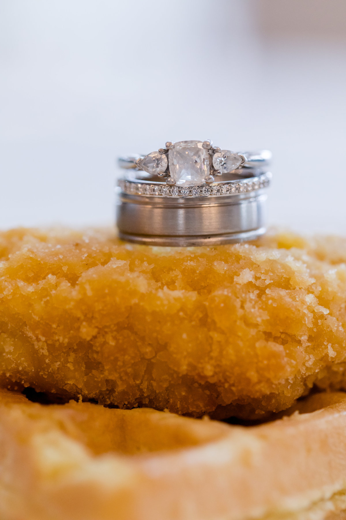 Wedding rings on top of chicken and waffles at Ospreys at Belmont Bay in Woodbridge