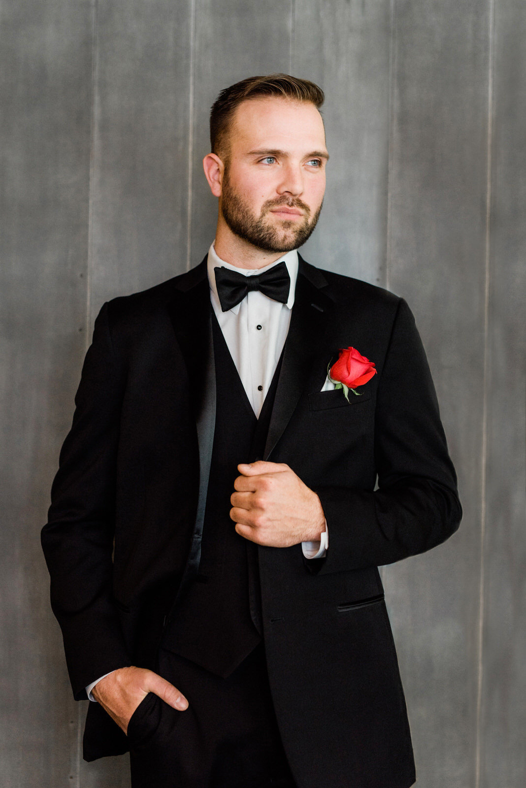 Gorgeous groom in black tuxedo