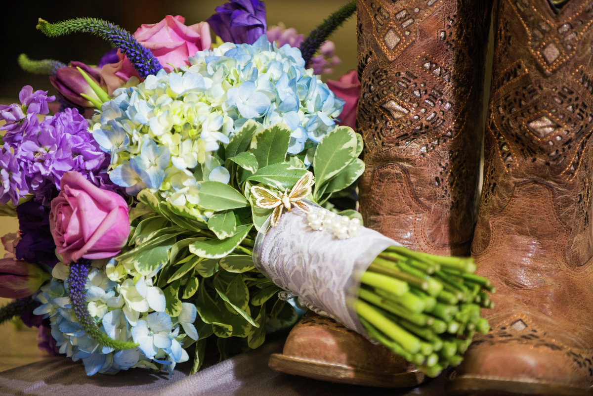 cowgirl boots bride with bouquet